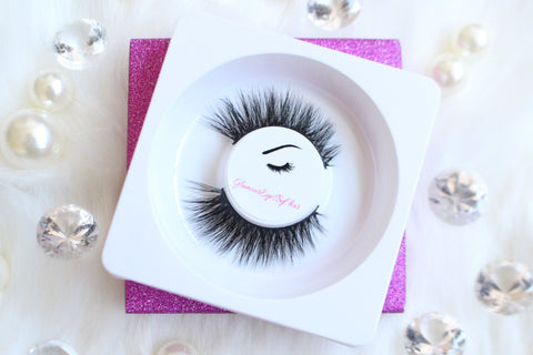 These 3D faux mink lashes are called Flirty and are 18mm in length. They're shorter on the inner corner and longer on outer corner for the forever-glam winged out effect. The thin lashband, makes the application process a breeze.  Flirty are perfect for a date night and can be worn up to 25 times if handled with care.   Lashes come with a cute bag, and a mascara wand so that you can take care of these beauties.