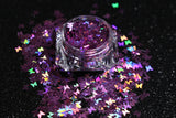 This glitter is called Holographic Purple Butterflies and is part of the shaped glitters collection. It consists of purple 3.0mm butterflies with a holographic sparkle. Holographic Purple Butterflies is perfect for nail and body art.