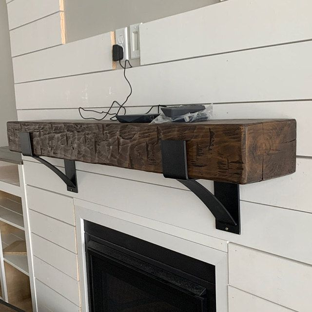 Lisa's fireplace mantel and beam chaqndelier