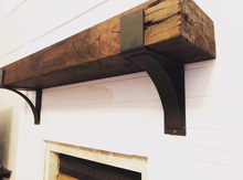 Load image into Gallery viewer, Janice's fireplace mantel with iron corbels