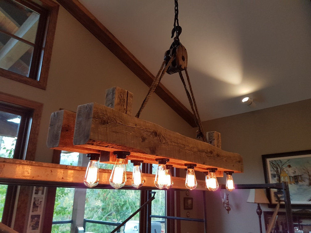 Rustic industrial beam chandelier with pulley