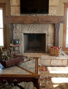 "Patty's full 6"" x 8"" x 70"" wood beam fireplace mantel which surrounds the fireplace"