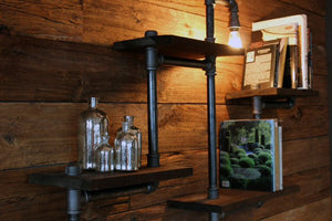 The prettiest reclaimed wood shelf with pipes