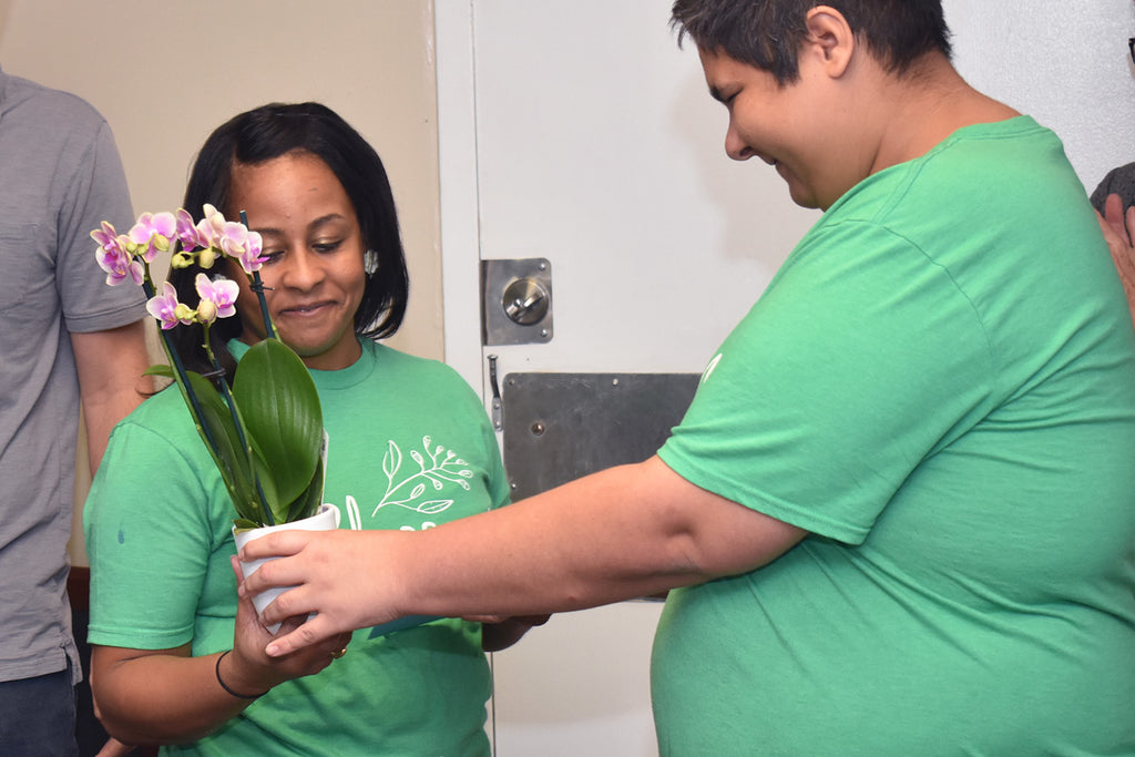 Crystal Julsaint is honored by Blossom crafters at a recent staff party.
