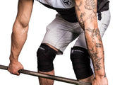 black knee wraps protects during deadlift