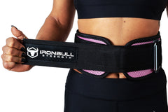 pink model putting on back support lifting belt
