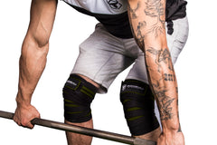 black-army-green knee wraps protects during deadlift