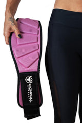 pink model holding 6 inches weight lifting belt