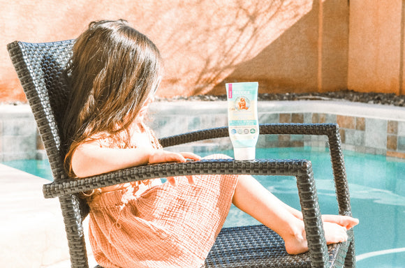 Girl With Sunscreen By Pool