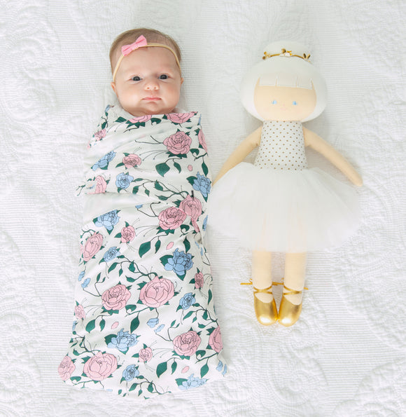 baby swaddled with snugababe floral swaddle