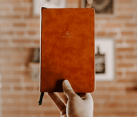 Monk Manual held in hand