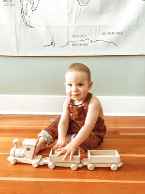 child playing with Large Wooden Toy Train