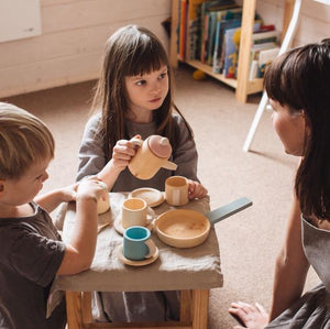 Children playing with a Pastel Wooden Toy Tea Set
