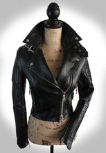Full View of Ladies Black Biker Jacket Partially Zipped Up on Mannequin