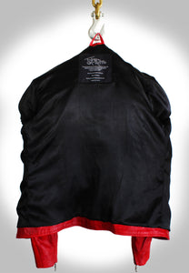 View of Inside Black Silk Lining of Red Biker Jacket Hanging on Industrial Hook