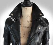 Close Up of Popped Up Collar of Ladies Biker Jacket on Mannequin