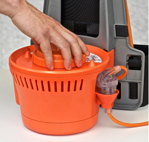 Hand resting on the Rugged Advantage motor filter showcasing how to clean it