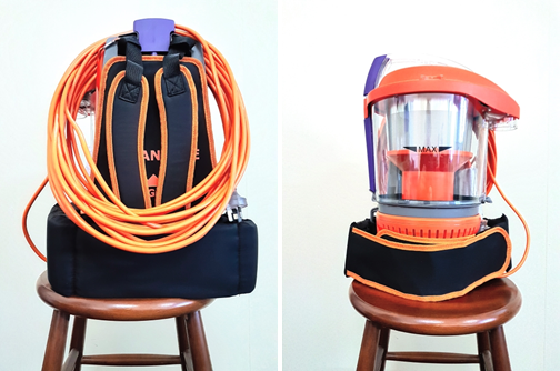 Rugged Advantage bagless backpack vacuum on a stool with the cord draped over the vacuum cleaner's frame