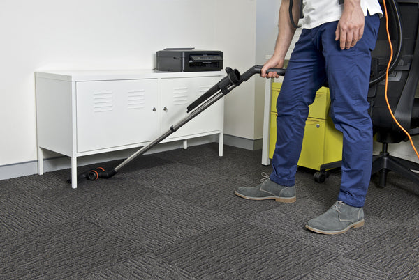 The EZ2GO cleaning under office cabinets