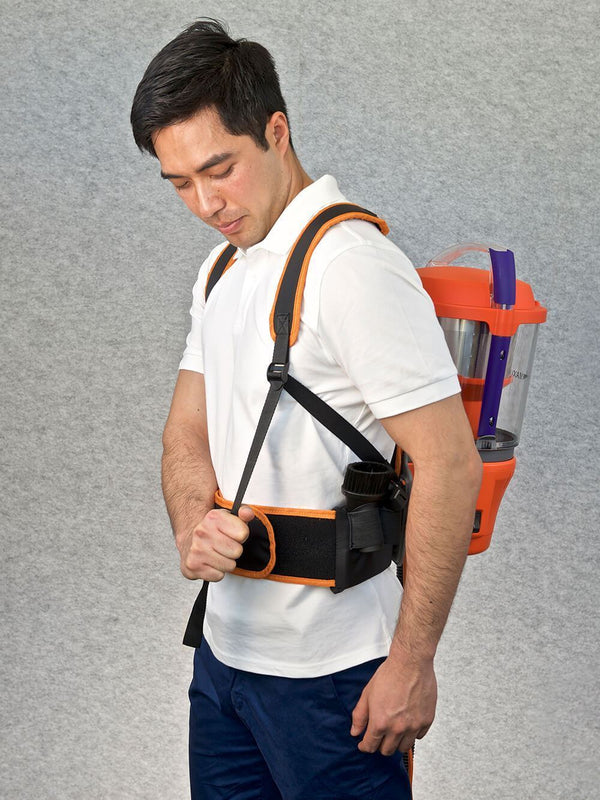 Adjusting the shoulder straps of the Advantage Ultimate Turbo Combo vacuum cleaner