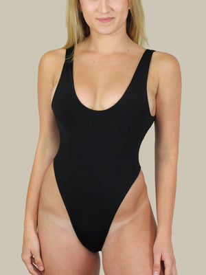 437 Swimwear's The Harlow One Piece in Black features a scoop neckline and high-cut leg. This is a classic one piece swimsuit with a cheeky bottom.