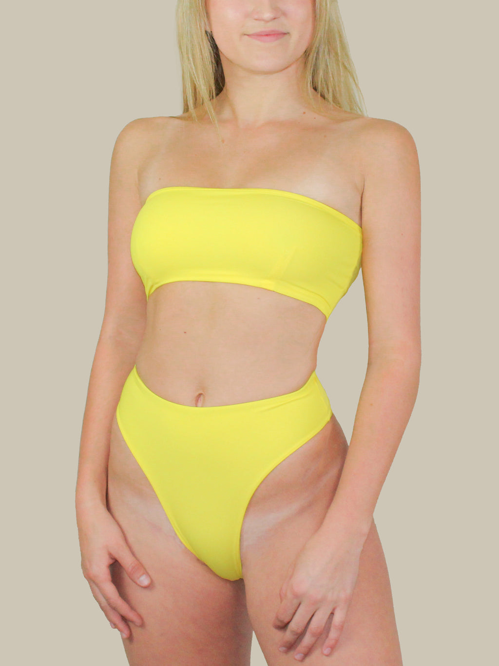 437 Swimwear's The Aubrey Top in Yellow features a strapless top and double layer fabric.