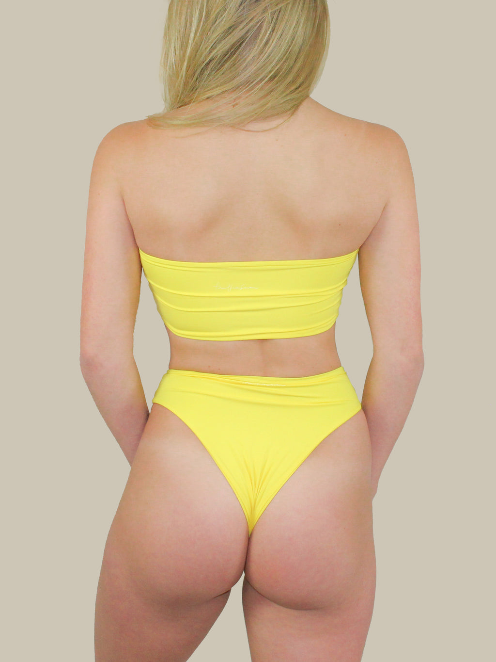 The Aubrey Bottoms in Yellow have a high-waisted fit with a high leg cut. These bottoms also have double layer fabric and bright yellow color.