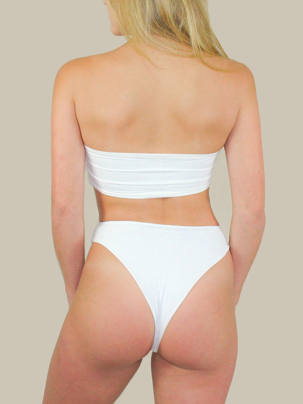 The Aubrey Bottoms in White feature a high waisted cut and have a high leg cut.