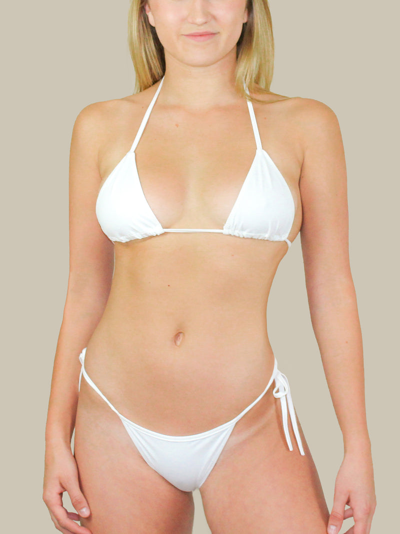 437 Swimwear's The Sanders Top is a white triangle bikini with ties at the neck and back. This Bikini Top is perfect for tanning with minimal tan line exposure.