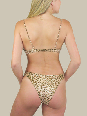 "That 90's Vibe Leopard ""U"" Bottom features a high-cut leg and leopard print. These bikini bottoms have minimal coverage and are perfect for tanning."