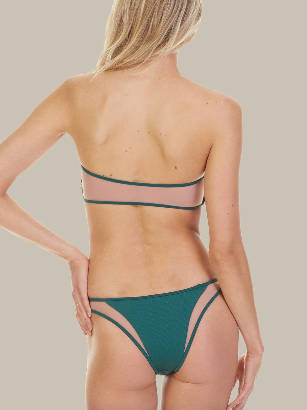 The Manon Bottoms are emerald green and feature mesh detail. These bikini bottoms also have minimal coverage and pair perfectly with the Royale Top.