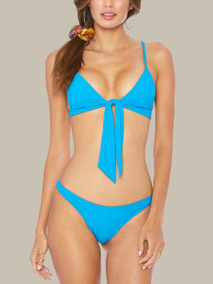 The ELLEJAY Izzy Top is a triangle bikini top with a front tie detail and has textured fabric. This top also has adjustable straps.