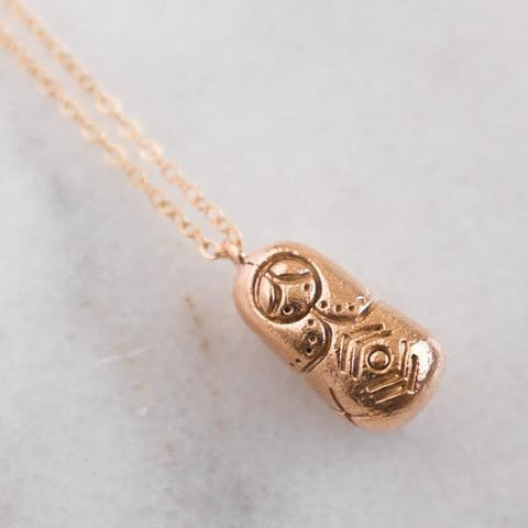Dawning Collective Bronze Matryoshka Necklace