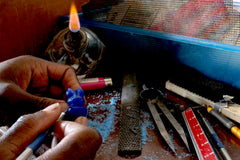 Picture of a person carving a wax ring for jewelry casting