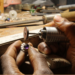 Picture of a person polishing jewelry with a flexshaft .