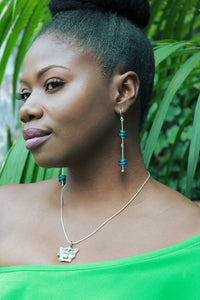 Woman wearing sterling silver Krobo dangle earrings