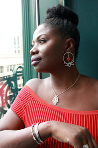 woman wearing sterling silver tribal krobo bead earrings