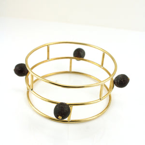 Gold toned architectural bangle bracelt with Ghanaian Krobo Beads