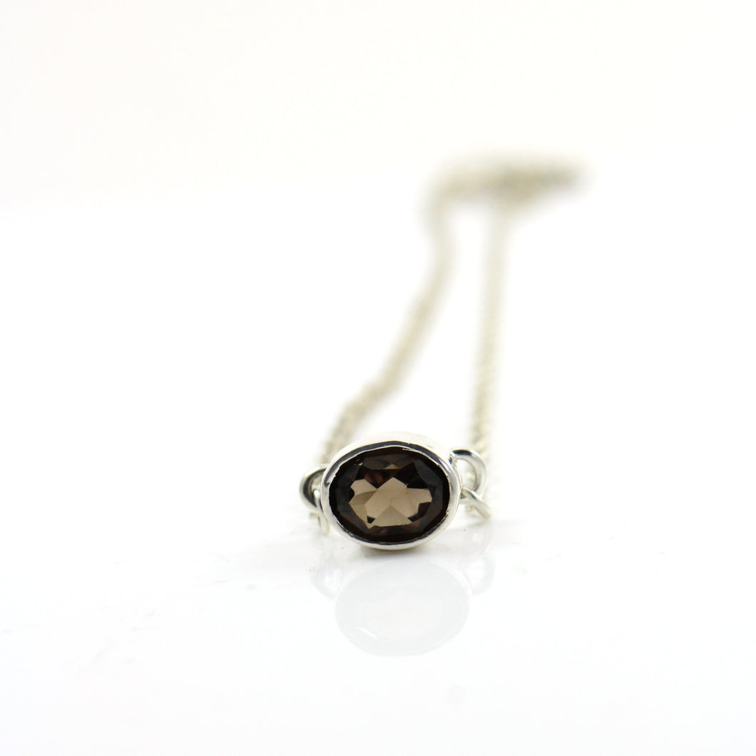 Oval smoky topaz gemstone pendant necklace.