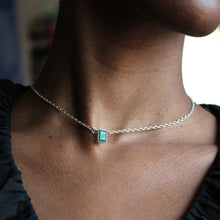Load image into Gallery viewer, woman in a black v neck shirt wearing an emerald cut green onyx pendant necklace in sterling silver