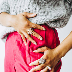 Woman wearing sterling silver architectural statement ring