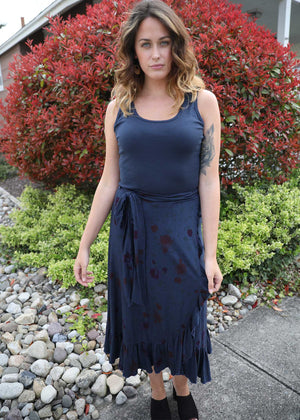Plume and Thread's model is wearing the LuLu skirt in navy