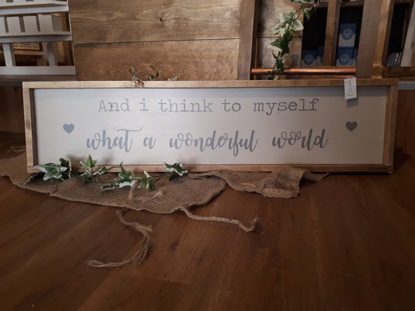 """AND I THINK TO MYSELF, WHAT A WONDERFUL WORLD"" SIGN"
