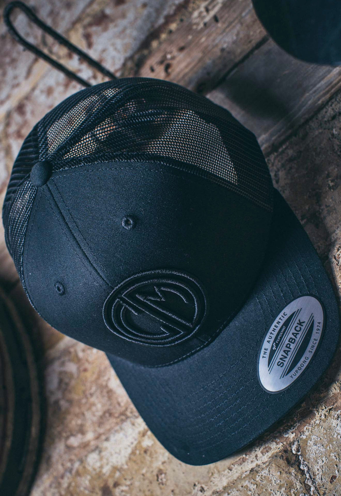 C&M Trucker Snapback. Black with Mesh.