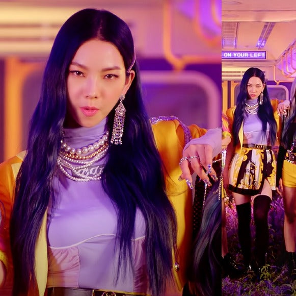 "ic: Karina in a Versace skirt. Featured in aespa's ""Black Mamba"" music video."