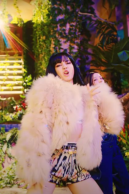 "ic: Lisa from BLACKPINK wearing an oversized fur jacket and printed shorts. Source: BLACKPINK ""How You Like That"" Official Music Video"