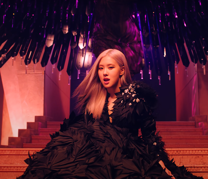 "ic: Rosé from BLACKPINK wearing a feathered black gown. Source: BLACKPINK ""How You Like That"" Official Music Video"