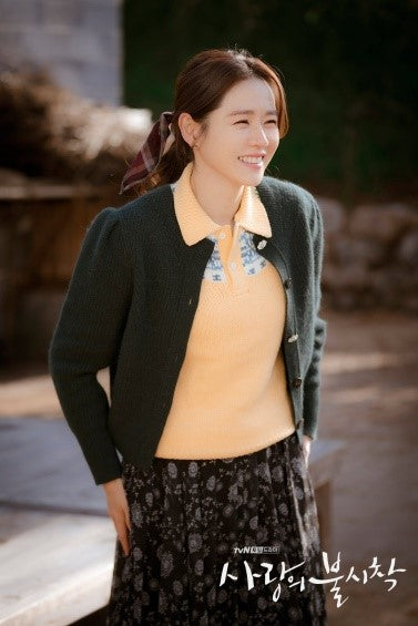 ic: Son Ye-jin as Yoon Seri in a Ralph Lauren polo, floral skirt from Eliden, and green cardigan. Featured in Crash Landing on You.