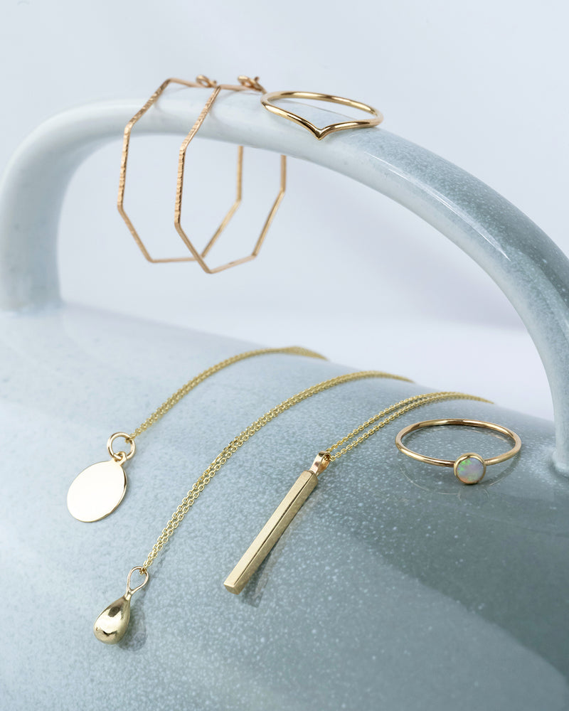 A display of solid gold jewellery made by independent designers, including rings, necklaces and earrings