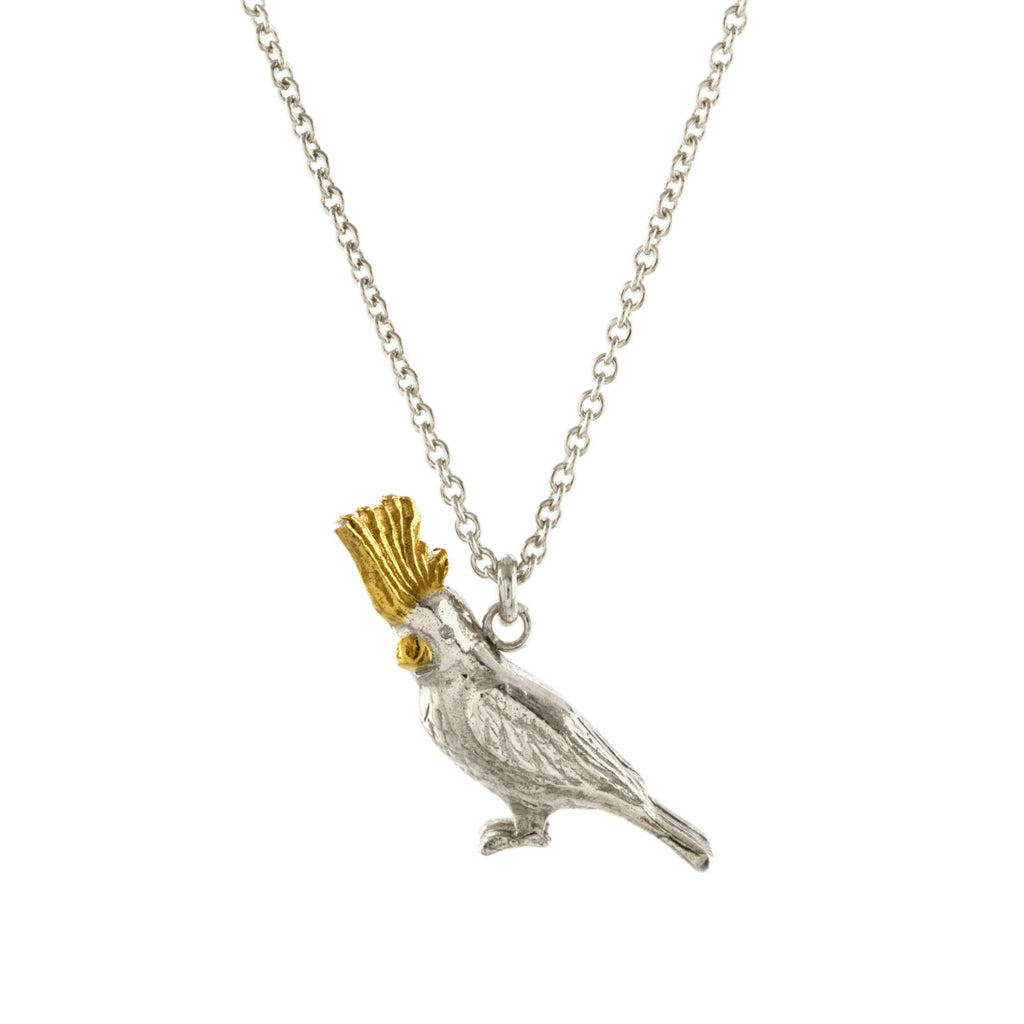 Silver and gold Cockatoo necklace on a silver chain by Alex Monroe, available at Magpiette.